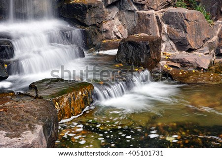 Waterfall with long shutter speed in park.