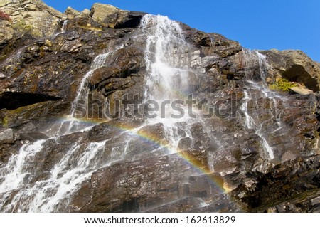 Waterfall with Rainbow, Teusadalen, Sjaunja Naturreservat, Laponia, Lapland, Sweden - stock photo