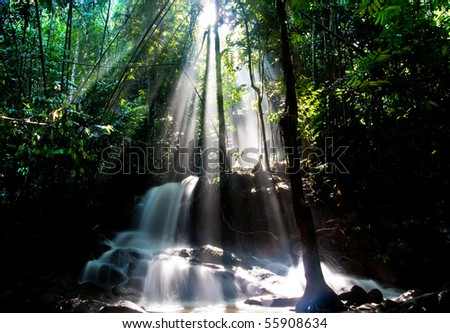 waterfall with ray of light - stock photo