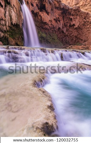 Waterfall with rocky foreground - stock photo