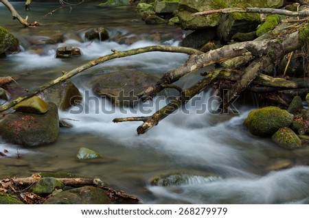 Waterfall with wood arc - stock photo