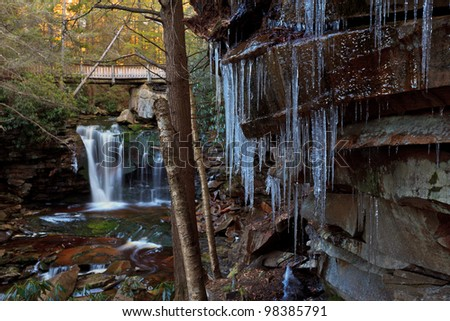 Waterfalls and icicles in the mountains - stock photo