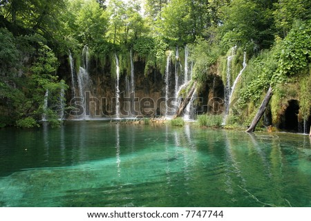Waterfalls and lakes in plitvice parc in Croatia. Clear blue water in a green and colorful nature