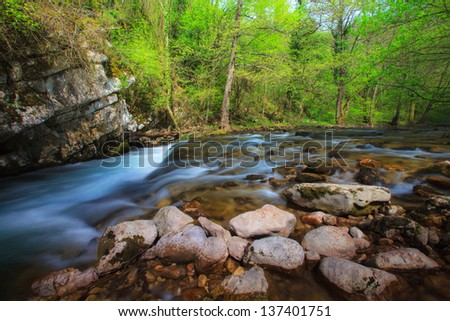 Waterfalls and mountain stream in the forest in spring in the Transylvania Alps