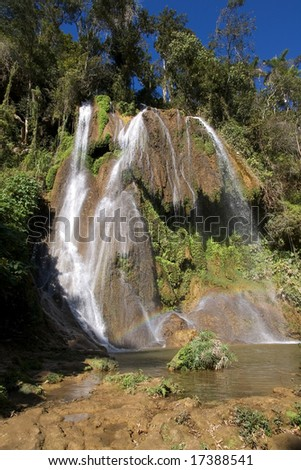 Waterfalls and rainbow under the stone in a province Trinidad, Cuba