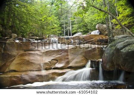Waterfalls, cascades, and pools of Diana's Baths in the White Mountains of New Hampshire.