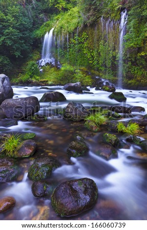 Waterfalls flow into the Sacramento River in Northern California.  - stock photo