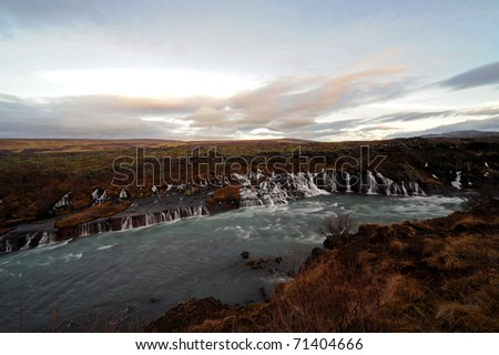 waterfalls Hraunfossar on the west coast of Iceland - stock photo