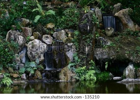 Waterfalls in a Japanese garden. - stock photo