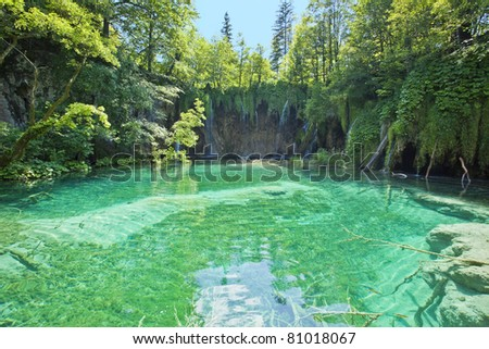 Waterfalls in national park falling into turquoise lake. Plitvice, Croatia - stock photo