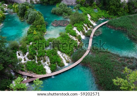 Waterfalls in Plitvice National Park. Aerial view. One vivid turquoise lake flows into another. - stock photo