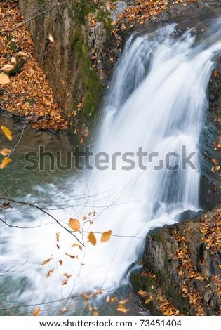 Waterfalls on Rocky Stream, Running Through Autumn Mountain Forest - stock photo
