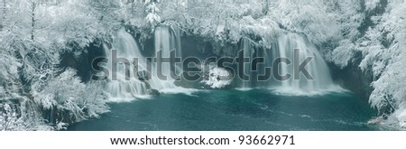 Waterfalls surrounded with snow - stock photo