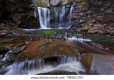 Waterfalls, tannin colored stream and rocks in the Appalachians - stock photo