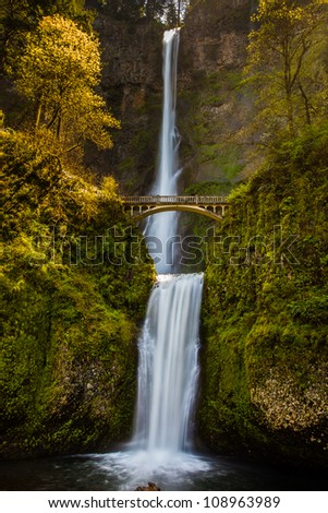 Waterfalls with bridge in late afternoon - stock photo