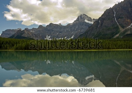 Waterfowl Lake, Banff National Park, Alberta - Mountains and clouds reflected in a calm lake