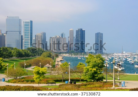 Waterfront and marina in Chicago, with tall buildings in the background - stock photo