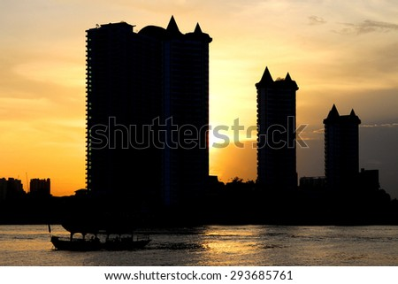 Waterfront Building silhouette at sunset. - stock photo