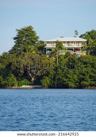 waterfront Caribbean hotel with lush tropical vegetation on an island of Bocas del Toro, Panama, Central America - stock photo