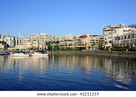 Waterfront Condominiums And Marina On The Shore Of False Creek Close To Granville Island In Vancouver (British Columbia, Canada) - stock photo