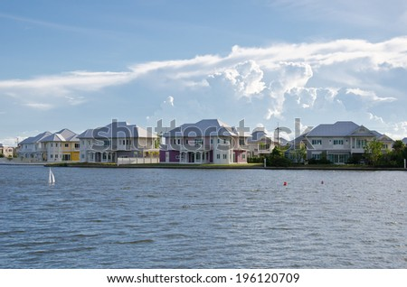 Waterfront homes, sky background - stock photo