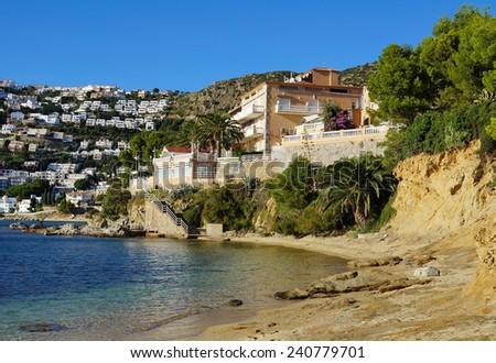 Waterfront hotel on the Mediterranean coast in Spain, Rosas, Costa Brava, Catalonia - stock photo
