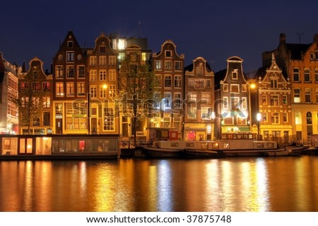 Waterfront houses in Amsterdam at night, The Netherlands (HDR image) - stock photo