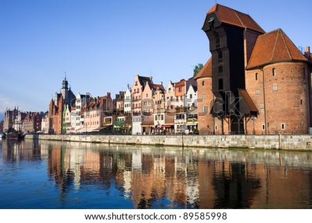 Waterfront of the Old Town along the river Motlawa in Gdansk, Poland, on the right side of the image The Crane (Polish: Zuraw) - stock photo