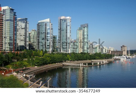 Waterfront of Vancouver Coal Harbor, with luxury condominiums and promenade, Canada