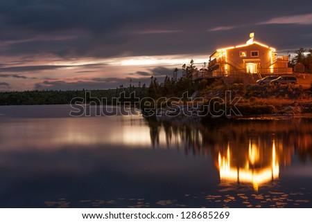Waterfront resort illuminated at night, Nova Scotia - stock photo