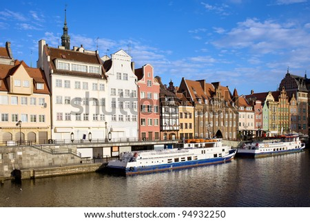 Waterfront scenery by the Motlawa river in the Old Town of Gdansk in Poland - stock photo