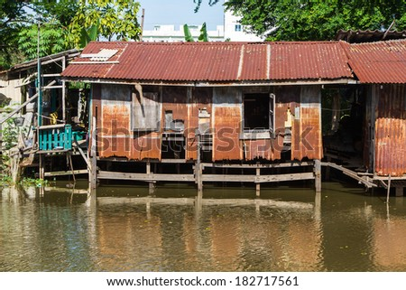 Waterfront zinc vintage old house in thai style, Thailand. - stock photo