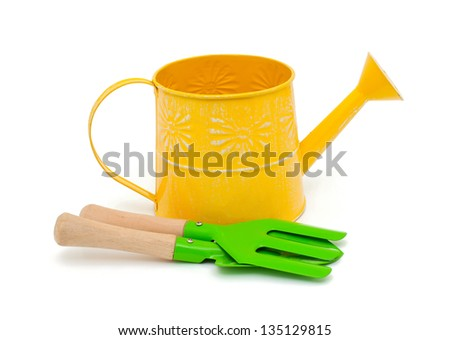 watering can and gardening tools isolated on white background - stock photo