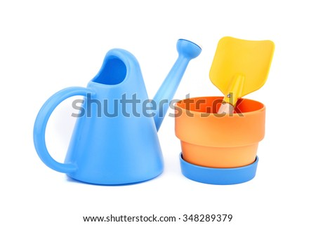 watering can, flower pot and trowel on white background.