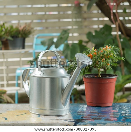 Watering can on a table