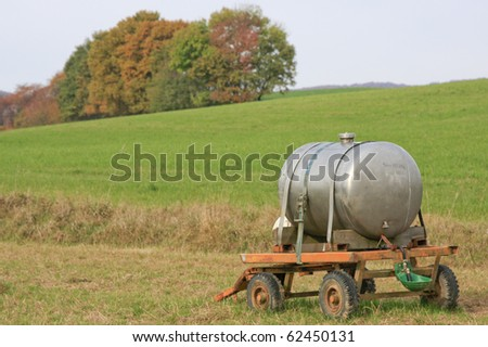 Watering cattle in a pasture