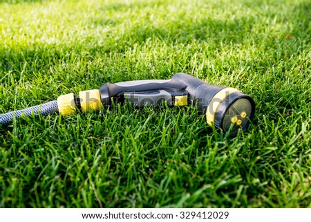 watering equipment for garden and lawn - stock photo