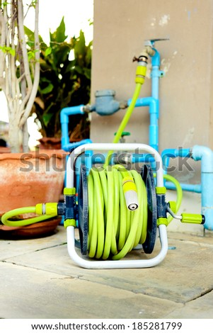 Watering garden hose on the spool - stock photo