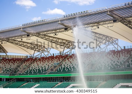 Watering grass on big sport stadium