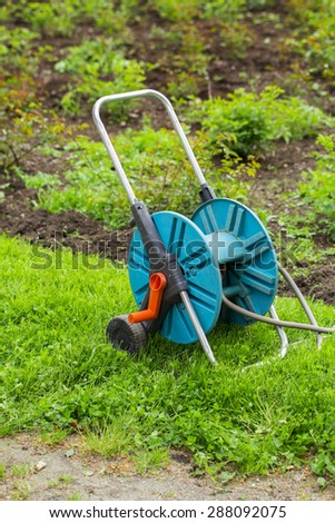 Watering hoses on the white background - stock photo