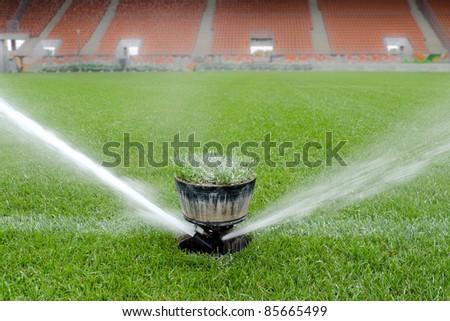 Watering turf - stock photo