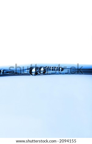 waterline with buoyant blue bubbles - stock photo