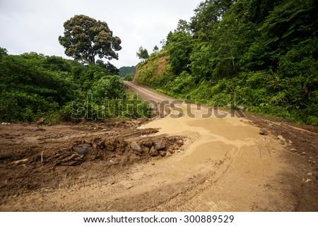 Waterlogged Dirt Road Leading Through Chin State Mountainous Region, Myanmar (Burma) - stock photo