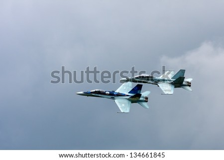 WATERLOO, ONTARIO - JUNE 3:  Two Royal Canadian Air force CF-18 2012 Demo Hornets take to the air on June 3, 2012 at the Waterloo Air show in Waterloo, Ontario, Canada. - stock photo