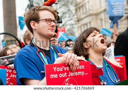 Waterloo Place, London, UK. 6th February 2016. EDITORIAL - Junior doctors and supporters, gather at a rally in central London, in protest of government plans to change NHS junior doctor contracts. - stock photo