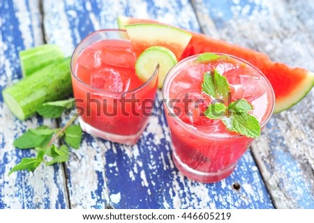 Watermelon and cucumber smoothie on wood table. - stock photo