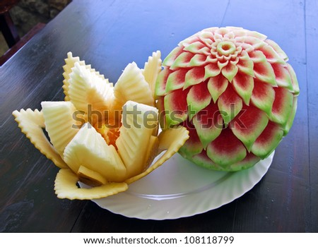 watermelon and melon carving on table - stock photo