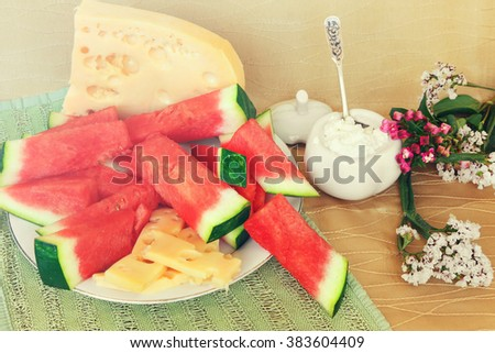 Watermelon, cheese and cottage cheese for snack or dessert. Mediterranean country style . Farm natural food for lunch or snack of  mediterranean. Image done in vintage instagram style - stock photo