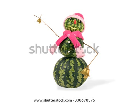 Watermelon christmas snowman with two golden bells in pink hat and scarf isolated. Holiday concept for New Years./Snowman made from watermelon with two golden bells in pink hat and scarf isolated. - stock photo