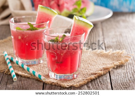 Watermelon drink in glasses with slices of watermelon - stock photo